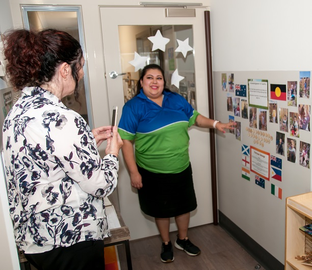 An educator explains her service's program to an authorised officer from the Education Standards Board during an assessment and rating visit.