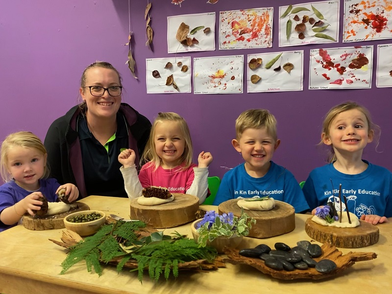 Sandra Trimper, Director Kin Kin Early Education, at a table with four children playing with natural objects