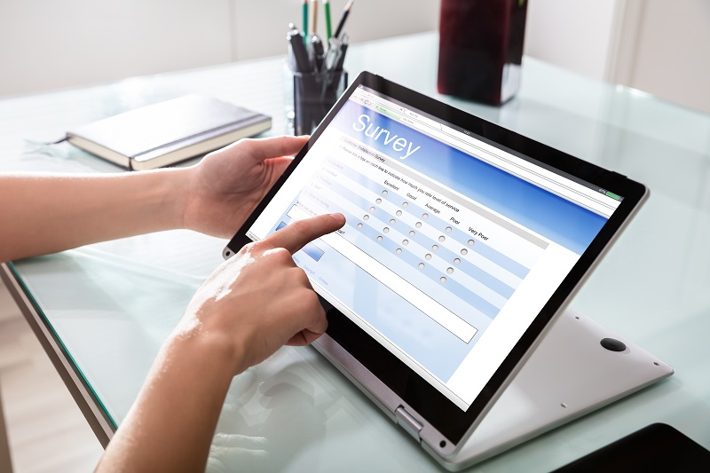 Person filling in online survey on a laptop
