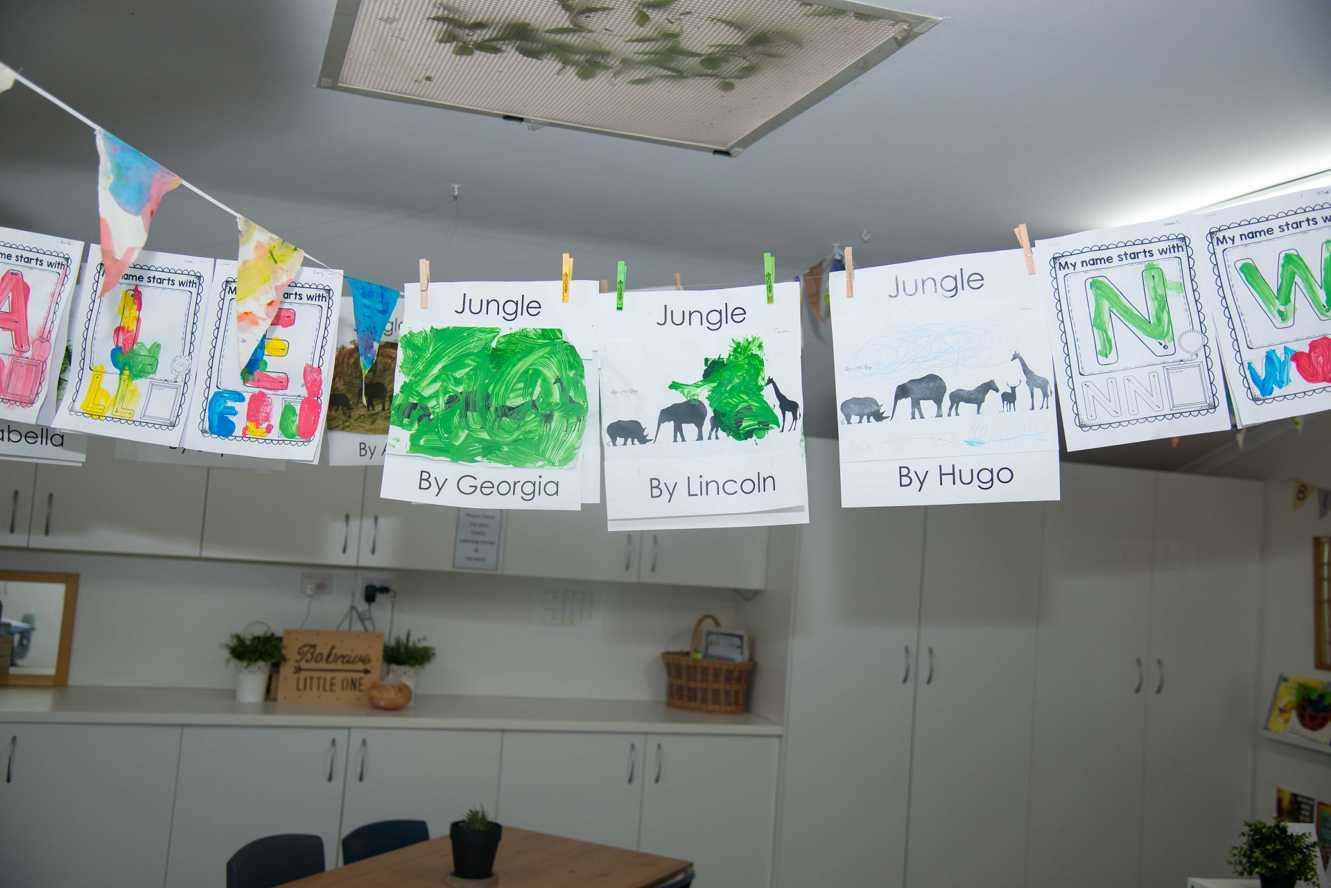 Image of jungle animals and letters painted by children at childcare