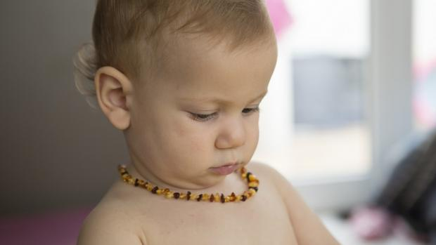 Baby wearing an amber necklace