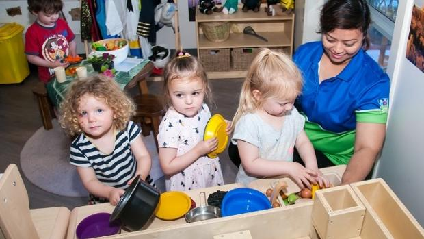 Children at a childcare centre play cooking