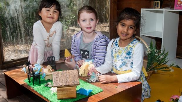 Three girls playing with fairies at preschool