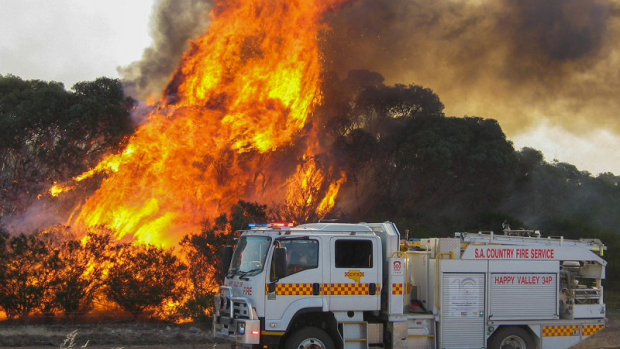 Bushfire in Happy Valley, South Australia with Country Fire Service truck in attendance