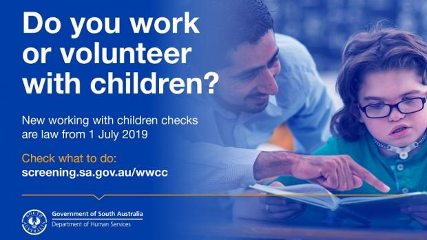 Advert for working with children checks by Department of Human Services, showing a male teacher helping a girl with reading